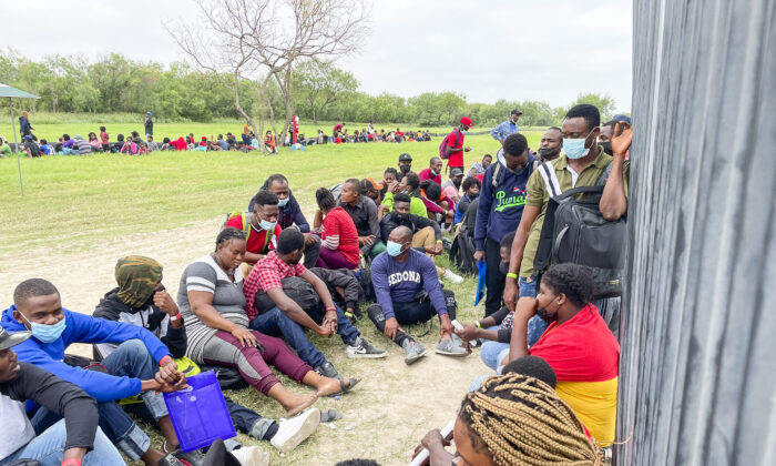 A group of more than 350 illegal immigrants wait for Border Patrol after crossing the Rio Grande from Mexico into Del Rio, Texas, on July 25, 2021. (Charlotte Cuthbertson/The Epoch Times)