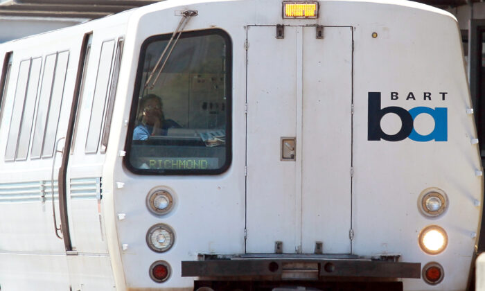 A Bay Area Rapid Transit (BART) train operator waits for passengers to enter the train at the Daly City station in Daly City, California on Aug. 15, 2011.  (Justin Sullivan/Getty Images)