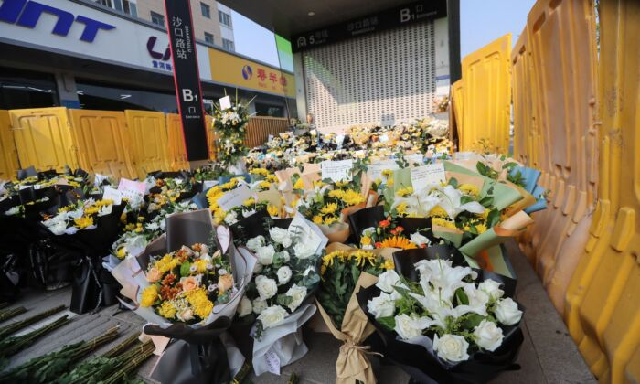Flowers placed as tributes are seen in front of a metro station in memory of flood victims in Zhengzhou, Central China's Henan Province on July 27, 2021. (STR/AFP via Getty Images)