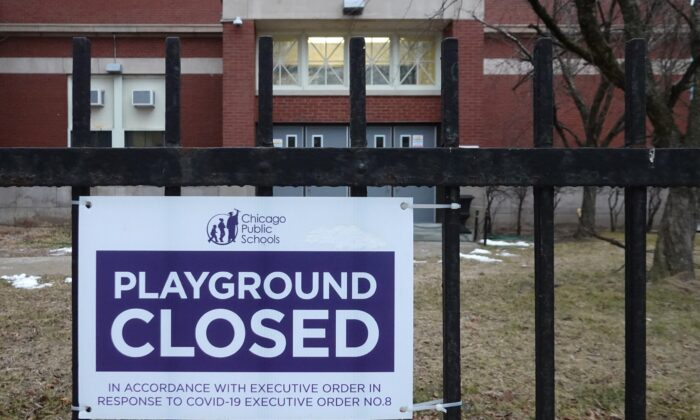 A sign outside of Columbus Elementary School lets visitors know that the playground has been closed  in Chicago, Illinois, on Jan. 25, 2021. Chicago Public School teachers were scheduled to return to the classroom for in-person learning, but the union objected and voted to continue remote learning.  (Scott Olson/Getty Images)