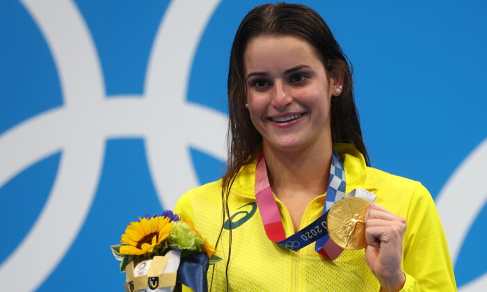 Kaylee McKeown of Team Australia poses with the gold medal after winning the Women's 100m Backstroke Final on day four of the Tokyo 2020 Olympic Games at Tokyo Aquatics Centre in Tokyo, Japan, on July 27, 2021. (Kai Pfaffenbach/Reuters