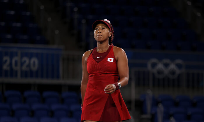 Naomi Osaka of Team Japan prepares to serve during her Women's Singles Third Round match against Marketa Vondrousova of Team Czech Republic on day four of the Tokyo 2020 Olympic Games at Ariake Tennis Park in Tokyo, Japan, on July 27, 2021. (David Ramos/Getty Images)