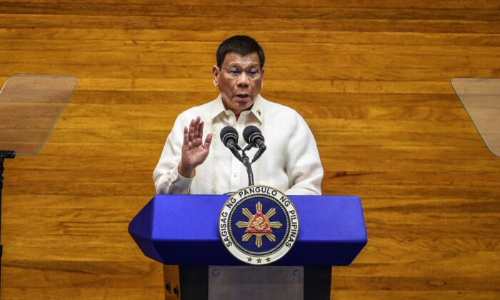 Philippine President Rodrigo Duterte gestures as he delivers his final State of the Nation Address at the House of Representatives in Quezon City, Philippines on July 26, 2021. (Jam Sta Rosa/Pool Photo via AP)
