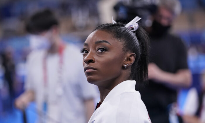 Simone Biles, of the United States, waits for her turn to perform during the artistic gymnastics women's final at the 2020 Summer Olympics, on July 27, 2021, in Tokyo. (Gregory Bull/AP Photo)