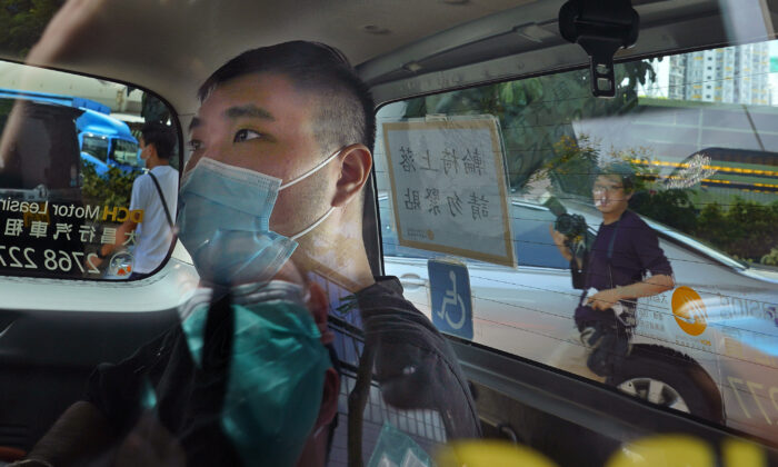 Tong Ying-kit arrives at a court in a police van in Hong Kong, on July 6, 2020. (Vincent Yu/File/AP Photo)