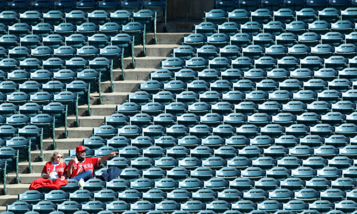 Fans look on during warm ups before the game between the Los Angeles Angels and the Cleveland Indians at Angel Stadium of Anaheim in Anaheim, Calif., on May 19, 2021. (Katelyn Mulcahy/Getty Images)
