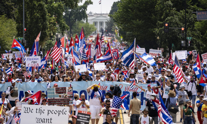 Cuban activists and supporters march from the White House to the Cuban Embassy on 16th Street during a Cuban freedom rally in Washington on July 26, 2021. (Drew Angerer/Getty Images)