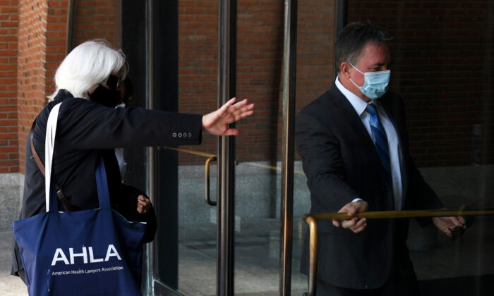Former police captain who went on to work for eBay Inc Philip Cooke arrives at court for sentencing in his cyberstalking case in Boston, Mass., on July 27, 2021.  (Nicholas Pfosi/Reuters)