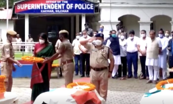 Police officers pay tribute to five police officers killed on July 27, 2021 during a clash with Mizoram, the border province of Assam, India.  (Screenshot via ANI / NTD via Reuters)