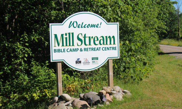 """A sign at the entrance to Mill Stream Bible Camp and Retreat Centre in Omemee, Ontario. A judge ruled that the youth camp was subjected to an """"unreasonable"""" decision when the federal government refused its application for $45,600 to fund six camp counsellor jobs for its 2019 summer camps. (BCM International)"""