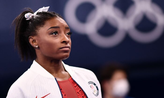 Simone Biles of the United States looks on during the artistic gymnastics women's team final during the Tokyo 2020 Olympic Games at the Ariake Gymnastics Centre in Tokyo, Japan, on July 27, 2021. (Loic Venance/AFP via Getty Images)