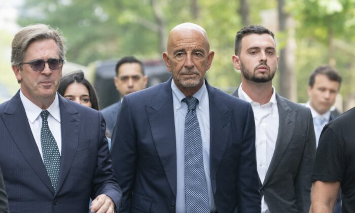 Thomas Barrack, center, arrives at federal court in New York on July 26, 2021. (Mark Lennihan/AP Photo)
