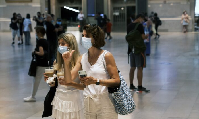 People wear masks while walking in Grand Central Terminal in New York City on July 27, 2021. (Spencer Platt/Getty Images)