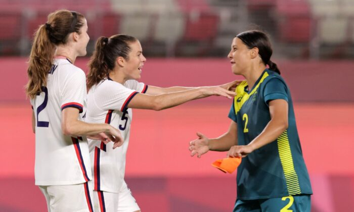 Samantha Kerr of Australia with Tierna Davidson of the United States and Kelley O'Hara of the United States after a women's soccer match at the 2020 Summer Olympics, in Kashima, Japan, on July 27, 2021. (Henry Romero/Reuters)