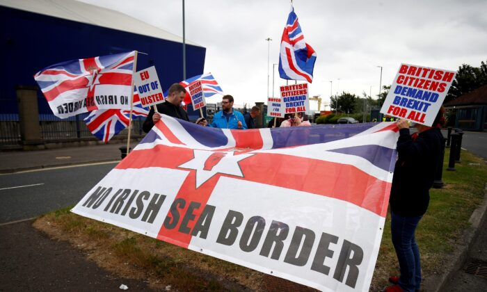 Loyalists protest against the Northern Ireland Brexit protocol at Belfast Harbour Estate, in Belfast, Northern Ireland, on July 3, 2021. (Jason Cairnduff/Reuters)