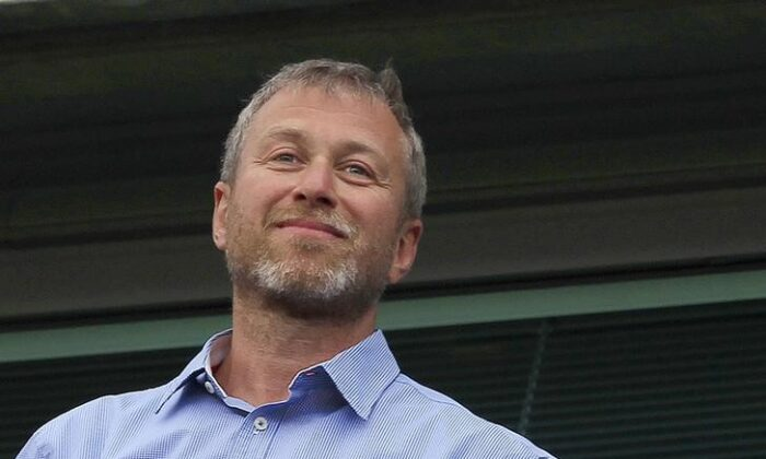 Chelsea owner Roman Abramovich watches the players do a lap of honour after their English Premier League soccer match against Blackburn Rovers at Stamford Bridge in London, on May 13, 2012. (Eddie Keogh/Reuters)