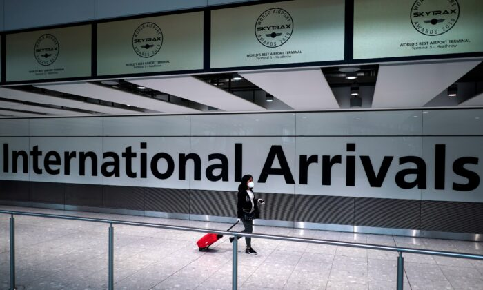 A traveler walks at Terminal 5 in Heathrow Airport in London on July 26, 2020. (Henry Nicholls/Reuters)