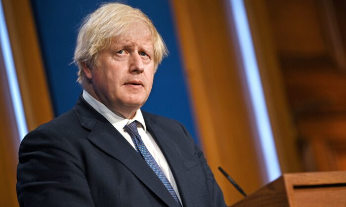 Britain's Prime Minister Boris Johnson looks on at a news conference inside the Downing Street Briefing Room in London, Britain, on July 12, 2021. (Daniel Leal-Olivas/Pool via Reuters)