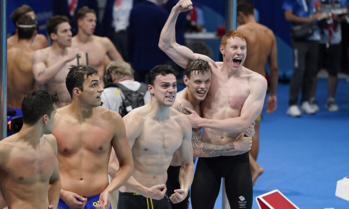 Britain celebrates after winning the mens' 4x200-meter freestyle relay at the 2020 Summer Olympics, in Tokyo, Japan, on July 28, 2021. (Charlie Riedel/AP Photo)