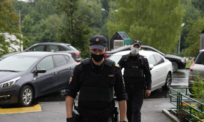 Police at the scene at the apartment block, where Roman Dobrokhotov, the chief editor of The Insider lives, in Moscow, Russia, on July 28, 2021. (Alexander Zemlianichenko/AP Photo)
