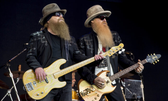 Dusty Hill (L) and Billy Gibbons (R) from U.S. rock band ZZ Top perform at the Glastonbury music festival in Somerset, England, on June 24, 2016. (Jonathan Short/Invision/AP)