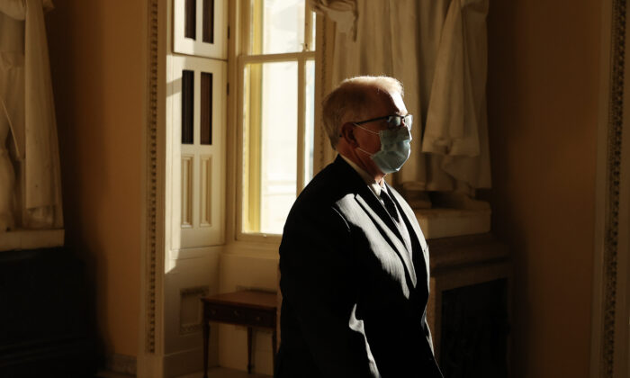Attending Physician of the United States Congress Dr. Brian Monahan walks through the U.S. Capitol before a series of votes on a $3 trillion economic package to aid people affected by the novel coronavirus pandemic in Washington on May 15, 2020. (Chip Somodevilla/Getty Images)