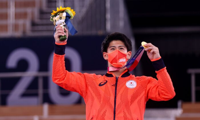 Daiki Hashimoto of Team Japan poses with his gold medal for the Men's Gymnastics All-Around Final at the Tokyo 2020 Olympic Games at Ariake Gymnastics Centre in Tokyo, Japan, on July 28, 2021. (Lindsey Wasson/Reuters)