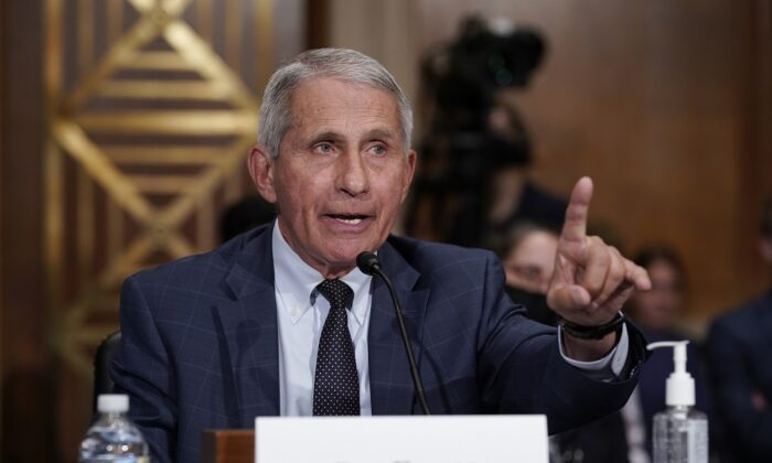 Dr. Anthony Fauci responds to accusations by Sen. Rand Paul (R-Ky.) as he testifies before the Senate Health, Education, Labor, and Pensions Committee, on Capitol Hill in Washington on July 20, 2021. (J. Scott Applewhite-Pool/Getty Images)