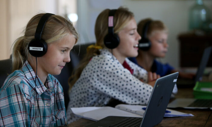 Kids do school work at their family home and cattle property on April 05, 2020 in Tarpoly Creek, Australia. (Getty Images)