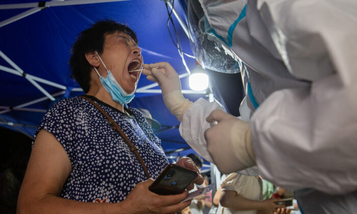 A resident is receiving a COVID-19 test in Nanjing, in eastern China's Jiangsu Province on July 21, 2021. (STR/AFP via Getty Images)