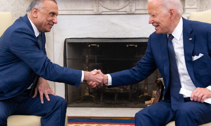 President Joe Biden shakes hands with Iraqi Prime Minister Mustafa al-Kadhimi (L) in the Oval Office of the White House on July 26, 2021. (Saul Loeb/AFP via Getty Images)