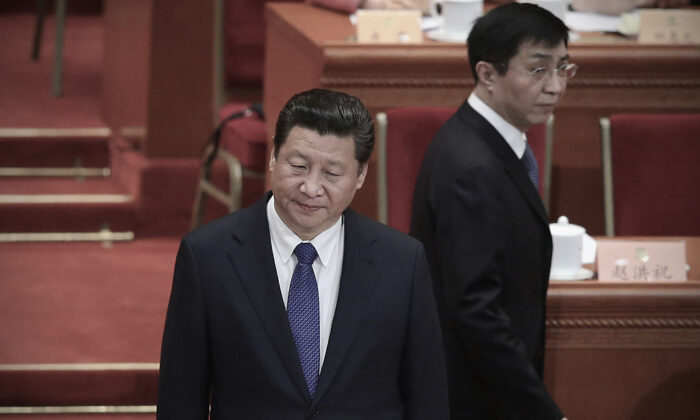Chinese leader Xi Jinping (L) and member of the Political Bureau of the CPC Central Committee Wang Huning (R) arrive at the closing session of the Chinese People's Political Consultative Conference at the Great Hall of the People in Beijing, China, on March 13, 2015. (Feng Li/Getty Images)