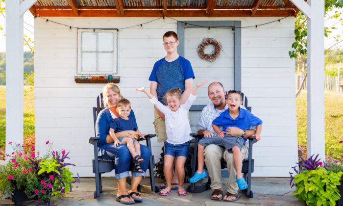 The Miller family: Lisa and Marlin (seated), and their children. (Landon Troyer/Plain Values)