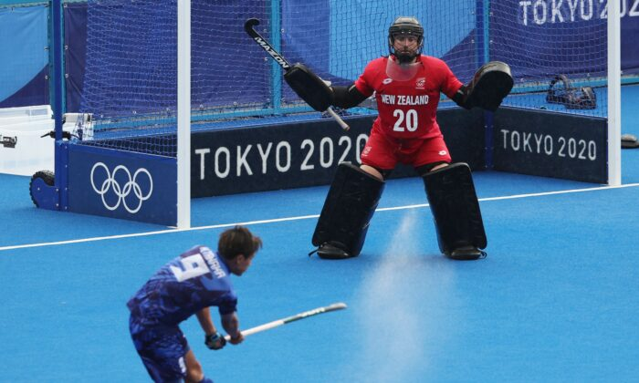 Leon Hayward of New Zealand defends against Kenta Tanaka of Japan during their men's pool A match of the Tokyo 2020 Olympic Games field hockey competition, at the Oi Hockey Stadium in Tokyo, Japan, on July 27, 2021. (Alkis Konstantinidis/Reuters)