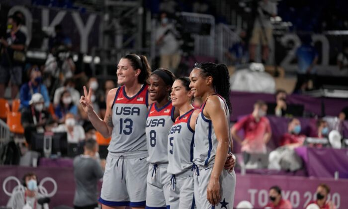 United States' Stefanie Dolson (13), Jacquelyn Young (8), Kelsey Plum (5), and Allisha Gray celebrate after defeating the Russian Olympic Committee in a women's 3-on-3 gold medal basketball game at the 2020 Summer Olympics, in Tokyo, Japan, on July 28, 2021. (Jeff Roberson/AP Photo)