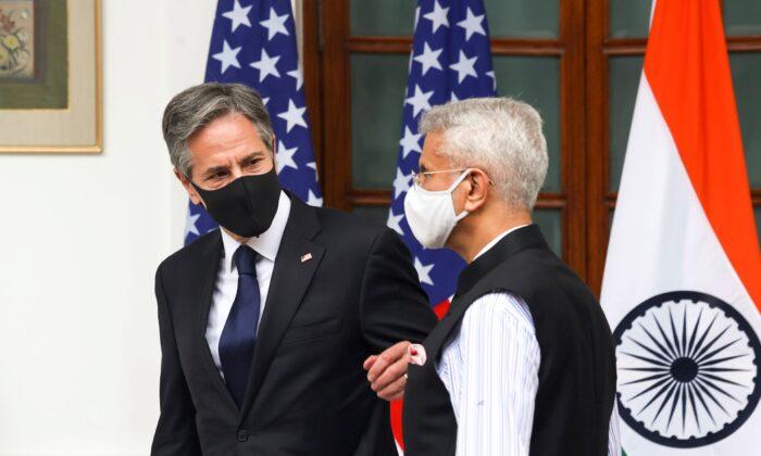 India's Foreign Minister Subrahmanyam Jaishankar, right, welcomes U.S. Secretary of State Antony Blinken at Hyderabad House in New Delhi, India on Wednesday, July 28, 2021.  (Jonathan Ernst/Pool Photo via AP)
