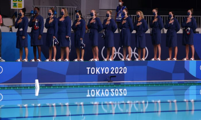 U.S. women's water polo team members listen to their national anthem ahead of a match at the 2020 Summer Olympics in Tokyo, Japan, on July 28, 2021. (Kacper Pempel/Reuters)