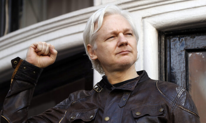 Julian Assange greets supporters outside the Ecuadorian embassy in London on May 19, 2017. (Frank Augstein/AP Photo)