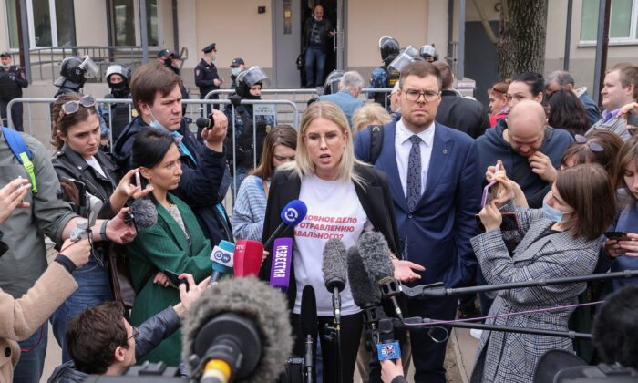 Lyubov Sobol, a Russian opposition figure and a close ally of Kremlin critic Alexei Navalny, speaks with journalists after a court hearing in Moscow, Russia, on April 15, 2021. (Tatyana Makeyeva/Reuters)