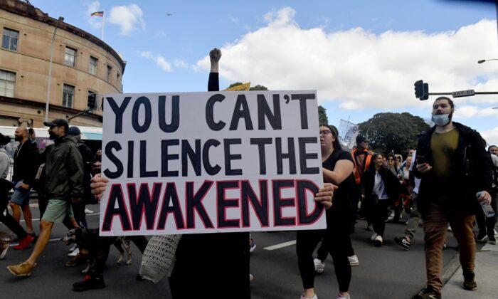 Protesters march along Broadway and George St towards Sydney Town Hall during the 'World Wide Rally For Freedom' anti-lockdown rally at Hyde Park in Sydney, Australia, on July 24, 2021. (Mick Tsikas/AAP Image)