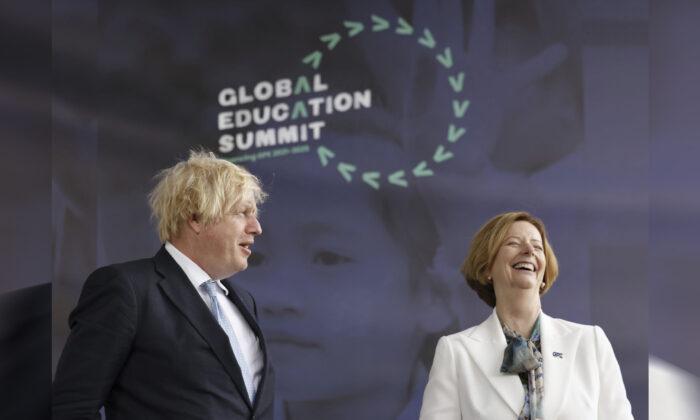 Britain's Prime Minister Boris Johnson alongside former PM of Australia Julia Gillard during a summit to raise funds for the Global Partnership for Education (GPE), in London, on July 29, 2021. (Tolga Akmen/PA via AP)