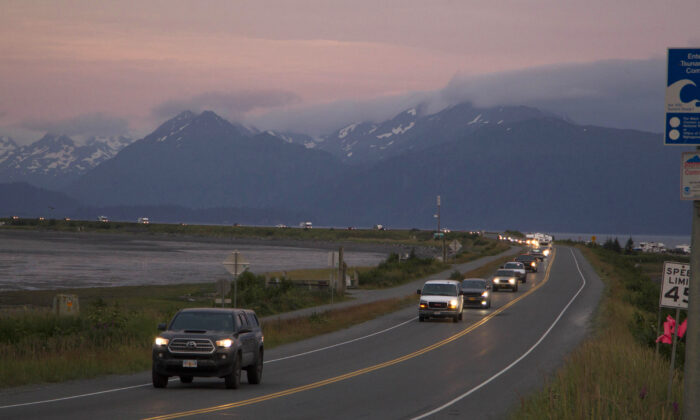A line of cars evacuating the Homer Spit in Homer, Alaska, on July 28, 2021, after a tsunami warning was issued following a magnitude 8.2 earthquake. (Sarah Knapp/Homer News via AP)