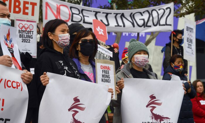 Activists including members of the local Hong Kong, Tibetan and Uyghur communities hold up banners and placards in Melbourne on June 23, 2021, calling on the Australian government to boycott the 2022 Beijing Winter Olympics over China's human rights record. (Photo by William WEST / AFP) (Photo by WILLIAM WEST/AFP via Getty Images)