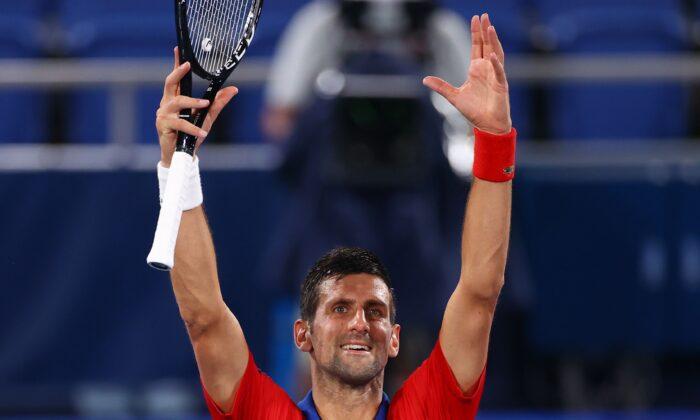 Novak Djokovic of Serbia celebrates after winning his quarterfinal match against Kei Nishikori of Japan during the men's singles quarterfinal of the Tokyo 2020 Olympics at Ariake Tennis Park in Tokyo, Japan, on July 29, 2021. (Edgar Su/Reuters)