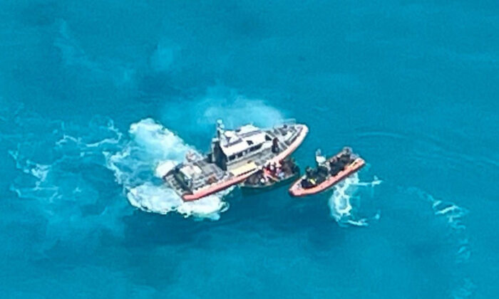 A Coast Guard Station Key West boat crew on scene with a 21-foot vessel with 22 people aboard approximately 7 miles south of Key West, Fla., on July 23, 2021. (U.S. Coast Guard Auxiliary)