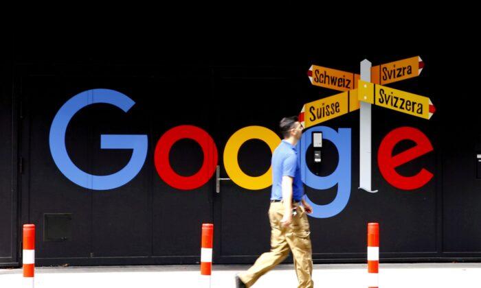 A man walks past a logo of Alphabet Inc.'s Google in front of an office building in Zurich, Switzerland, on July 1, 2020. (Arnd Wiegmann/Reuters)