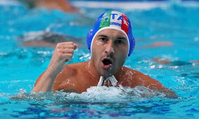 Italy's Pietro Figlioli celebrates after a score against the United States during a preliminary round men's water polo match at the 2020 Summer Olympics, in Tokyo, Japan, on July 29, 2021. (Mark Humphrey/AP Photo)