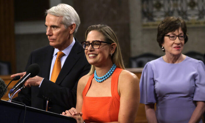 Sen. Rob Portman (R-Ohio) (L) and Sen. Kyrsten Sinema (D-Ariz.) (C) answer questions from members of the press as Sen. Susan Collins (R-Maine) looks on during a news conference on Capitol Hill in Washington, on July 28, 2021. (Alex Wong/Getty Images)