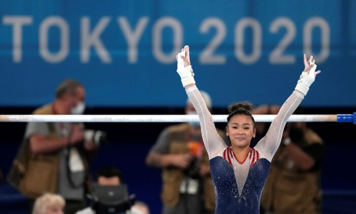 Sunisa Lee of the United States finishes on the uneven bars during the artistic gymnastics women's all-around final at the 2020 Summer Olympics in Tokyo, Japan, on July 29, 2021. (Ashley Landis/AP Photo)
