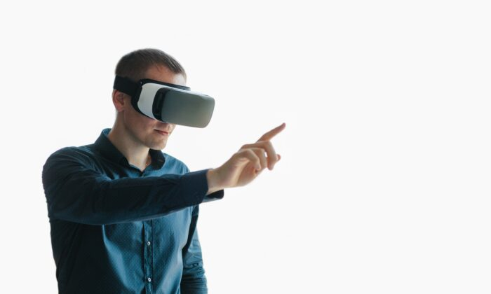 Virtual reality headsets offer a new form of entertainment—and new technology-related side effects. (franz12/Shutterstock)